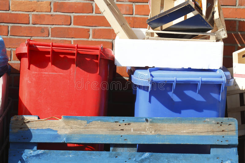 Red and blue recycling bins stock photos