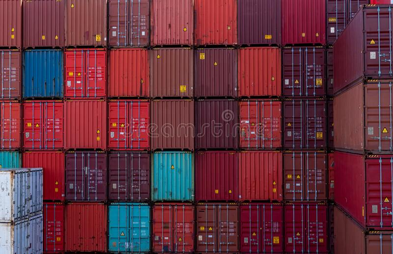 Red and blue shipping container stacked up together australia stock images