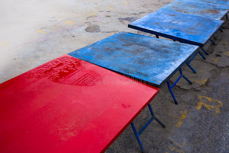 Red and blue steel table for Thai weekend market. royalty free stock images