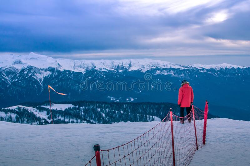 Red on blue on top of a mountain. Mountains and clouds hiding the sky. the fine given. Beautiful horizon. Infinity. Sochi, Russia. Rosa Khutor. Great view from stock photos
