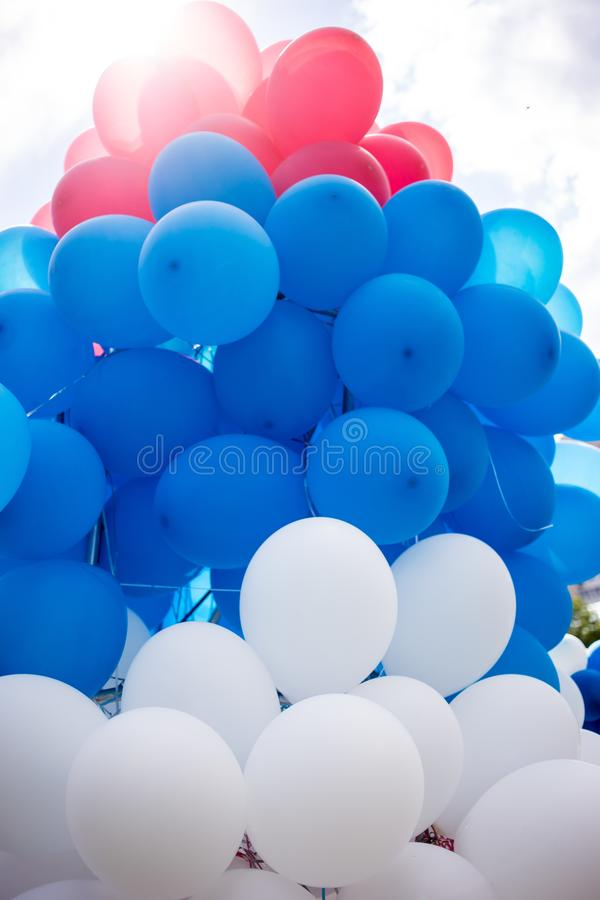 red, blue and white balloons in the form of the flag of Russia stock photos