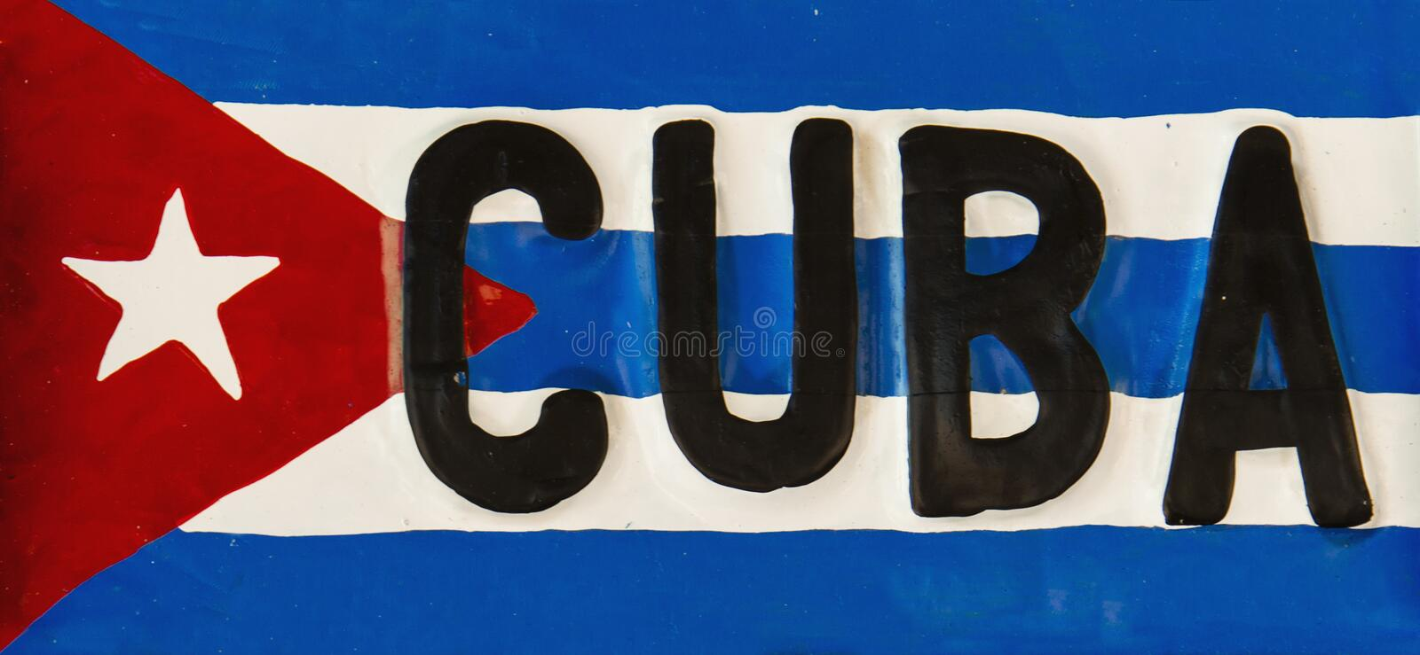 Red-blue-white Cuban flag on metal plate, Cuba stock photos