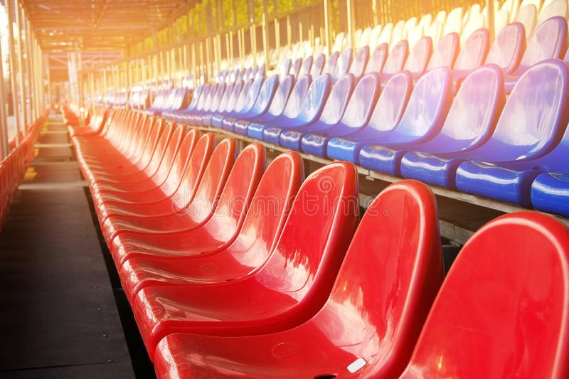 Red, blue and white sports stadium seats. Empty stands, no spectators at the competitions.  royalty free stock image
