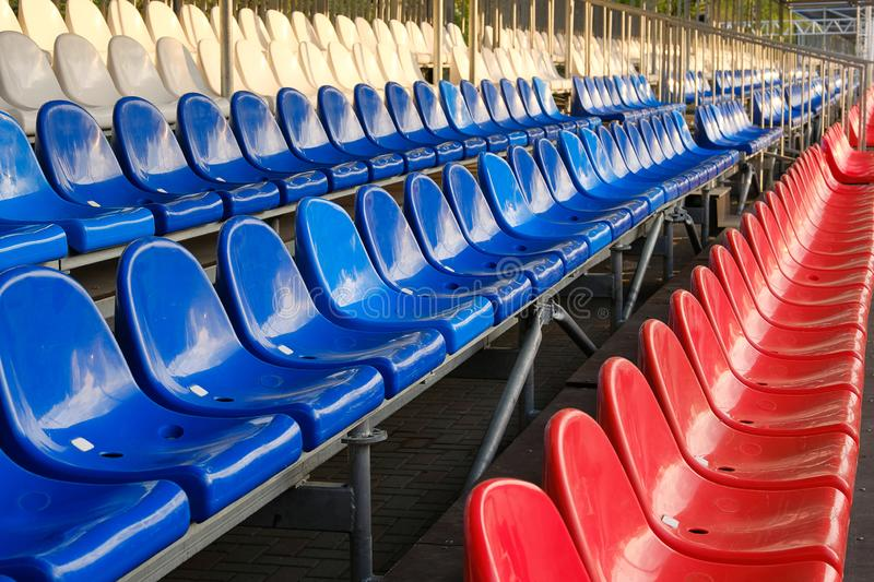 Red, blue and white sports stadium seats. Empty stands, no spectators at the competitions.  royalty free stock photo