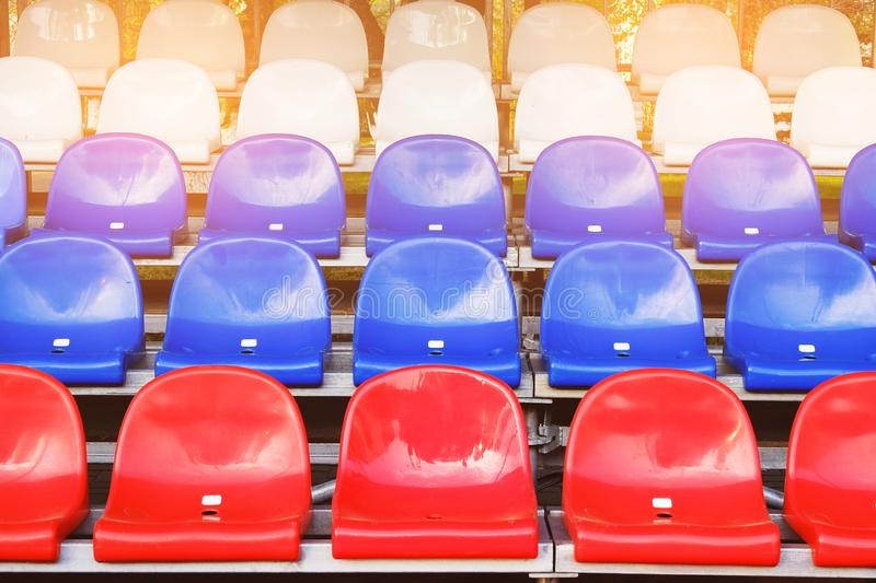 Red, blue and white sports stadium seats. Empty stands, no spectators at the competitions.  stock photo