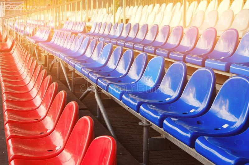 Red, blue and white sports stadium seats. Empty stands, no spectators at the competitions.  royalty free stock images