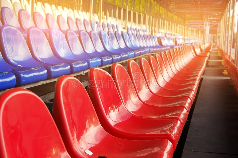 Red, blue and white sports stadium seats. Empty stands, no spectators at the competitions.  royalty free stock photos