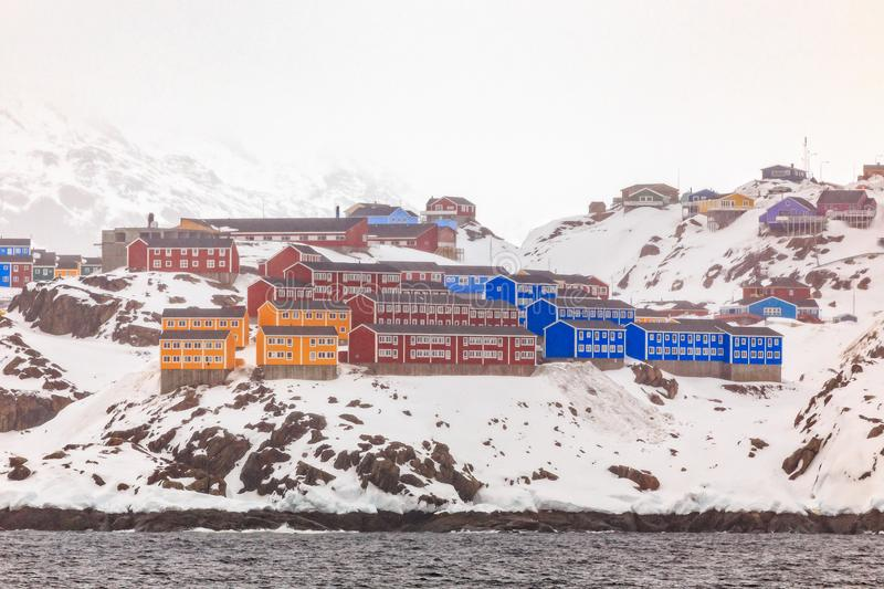 Red, blue and yellow living houses on the rocky hills of Sisimiut the 2nd largest Greenlandic city stock photo