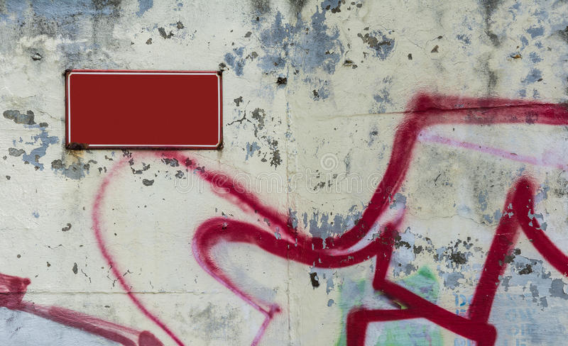Red board on white flaked wall royalty free stock images
