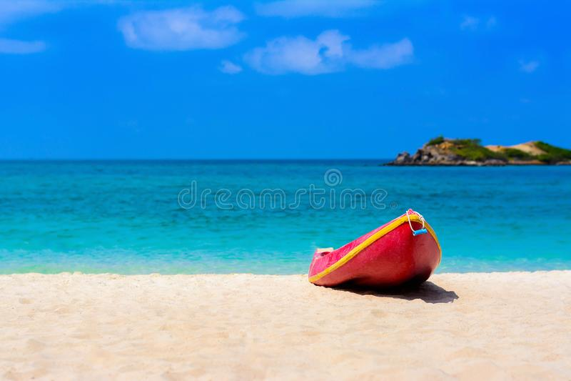 Red boat on the beach with blue sea and blue sky. Background stock images