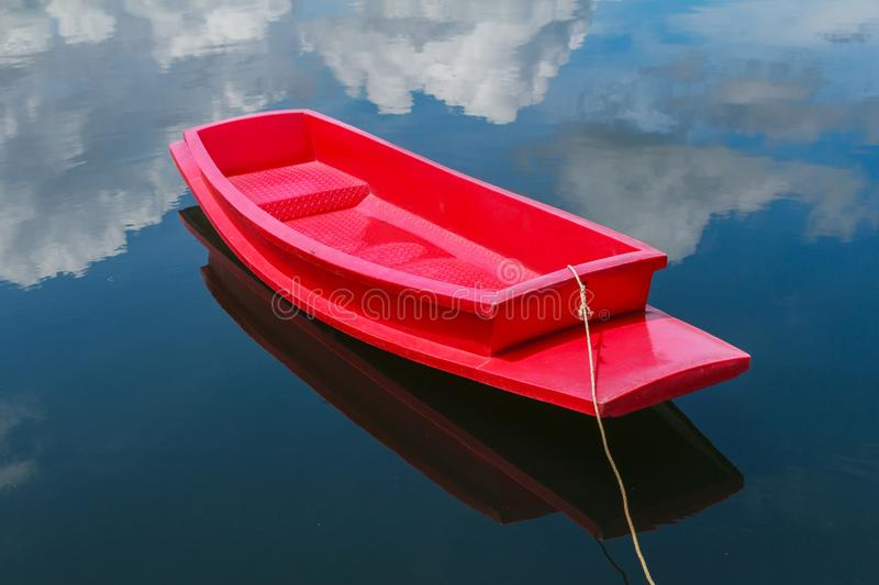 Red boat. Floats in the lake royalty free stock photography