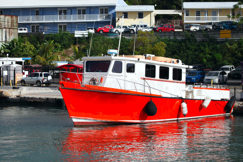 Red boat. By a small caribbean fishing village royalty free stock image