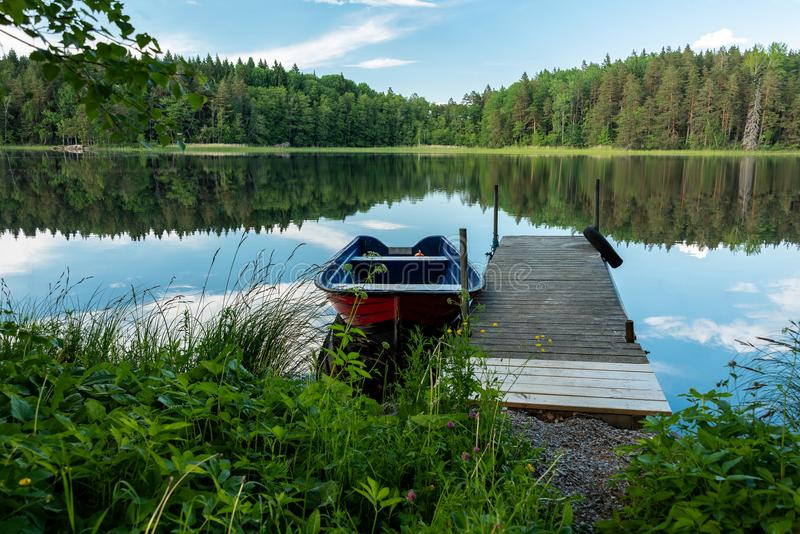 Red boat by wooden bridge stock photos