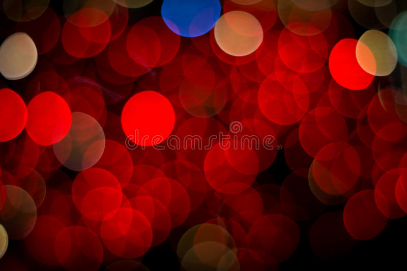 Red bokeh. Lights on black background royalty free stock photography