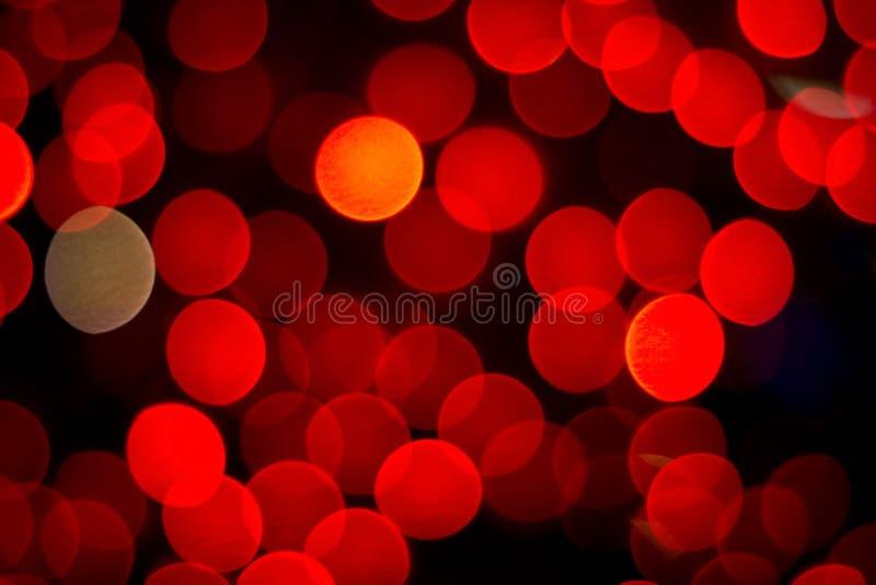 Red bokeh. Light on black background stock image