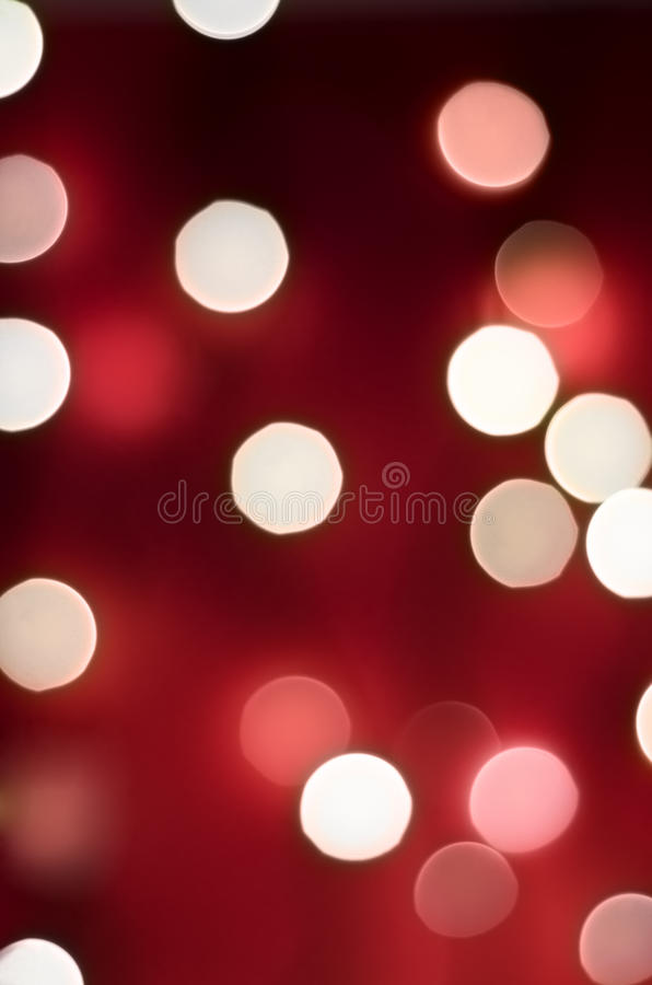 Red Bokeh Lights. Bokeh lights with rich red background blending into darkness, portrait orientation royalty free stock image