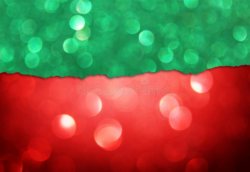 Red bokeh lights and green torn paper royalty free stock images