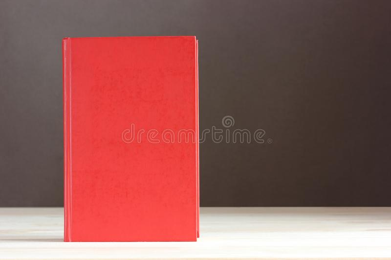 Red book with a blank cover. Empty space for Your text royalty free stock photography