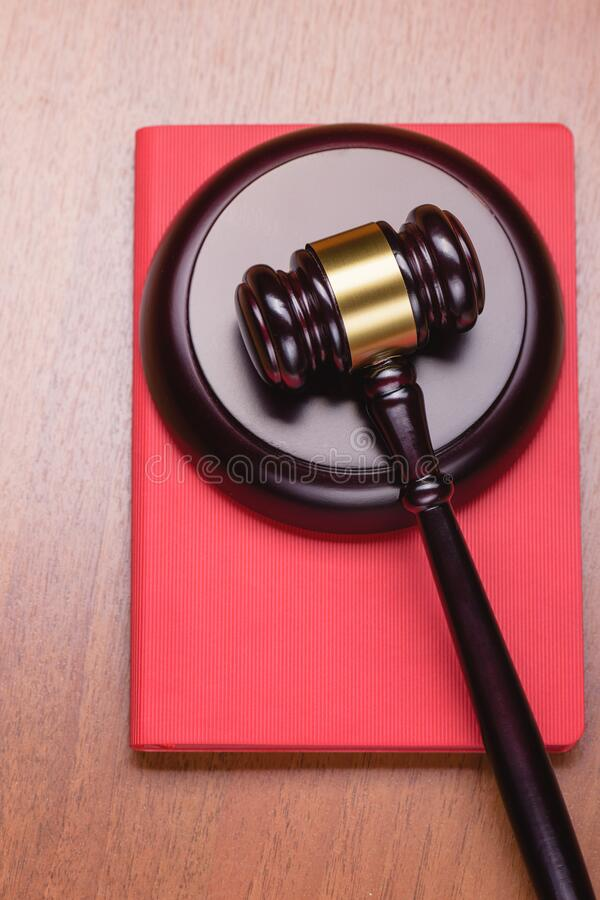 Red Book of the Criminal Code. Book for records. Fair trial. Judge`s wooden gavel on the table. Right to a lawyer. Judicial law royalty free stock images