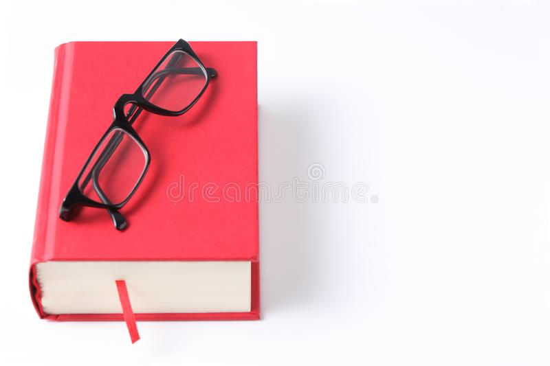 Red book and eye glasses isolated on white background with copy space for your text. Red book and eye glasses isolated on white background with copy space stock images