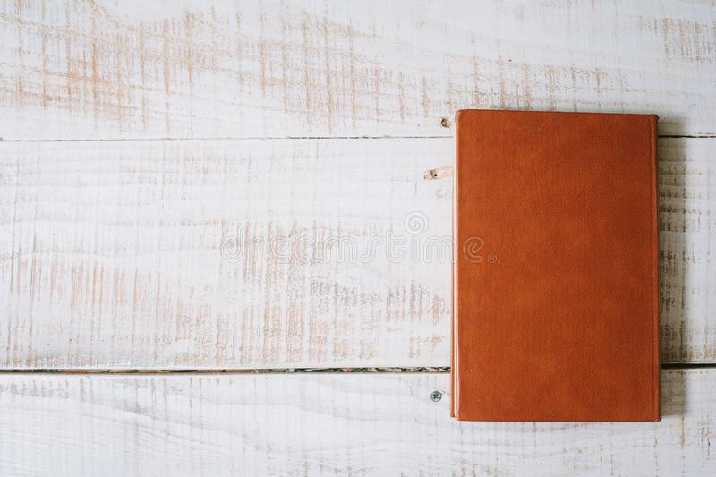 red book and hourglasses lie on a wooden table. top view. layflat. stock image