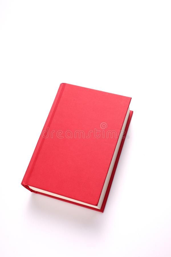 Red book isolated on white background with copy space for your text clipping path included. Red book isolated on white background with copy space and clipping royalty free stock photos