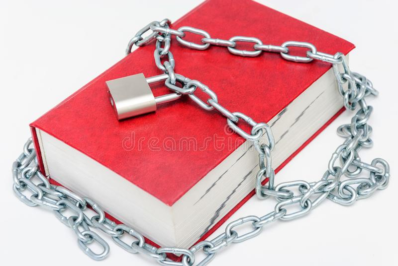 Red book on the lock with a chain stock images
