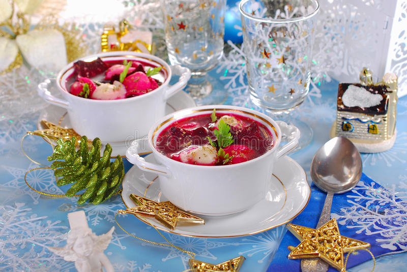 Red borscht with ravioli for christmas stock photo