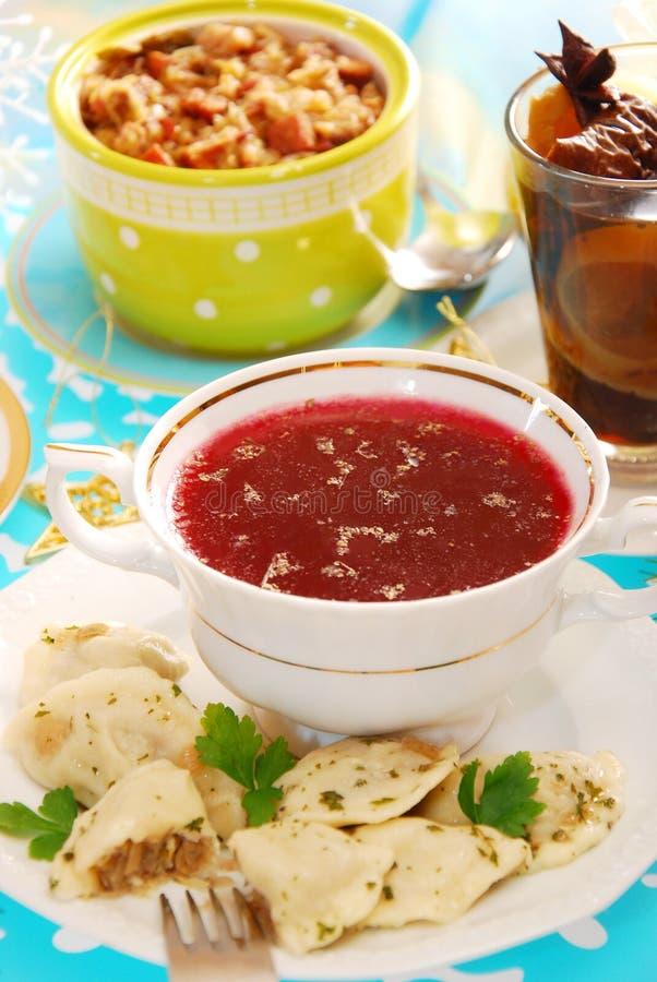 Red borscht and ravioli (pierogi) for christmas stock images