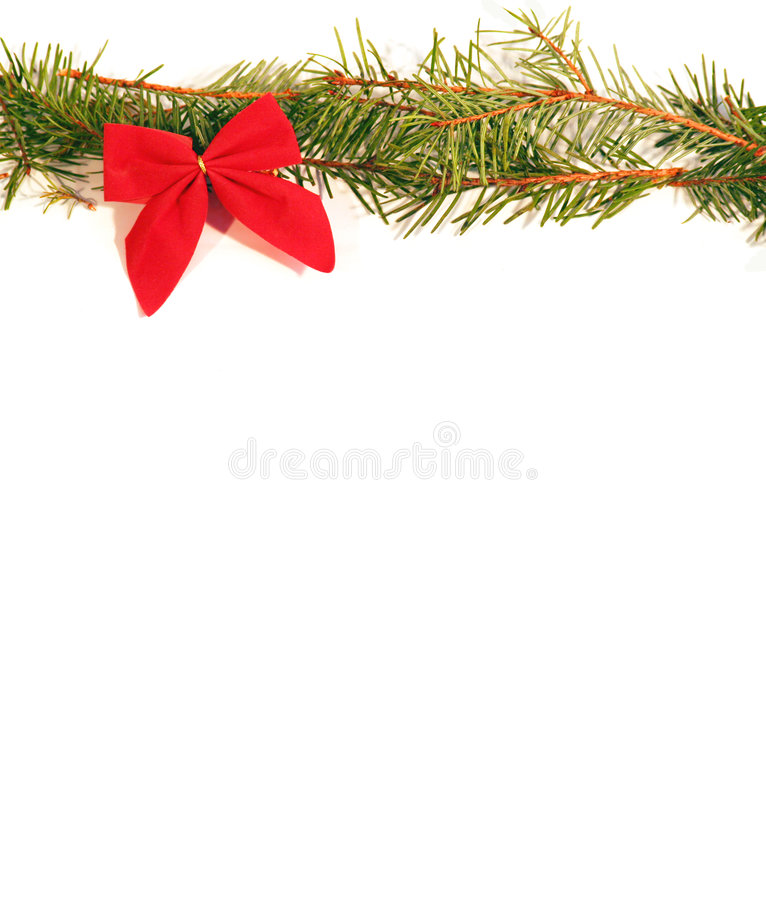 Red Bow. A red bow and pine bough background/copy space royalty free stock photos