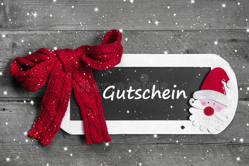 Red bow on chalk board with Voucher - coupon stock images