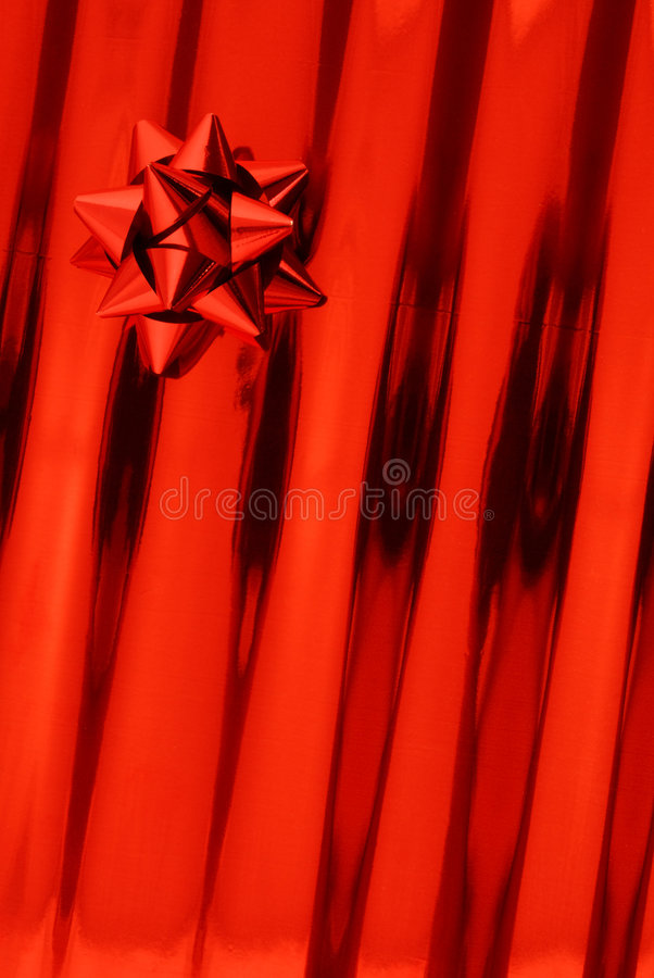 Red bow and gift paper stock photo