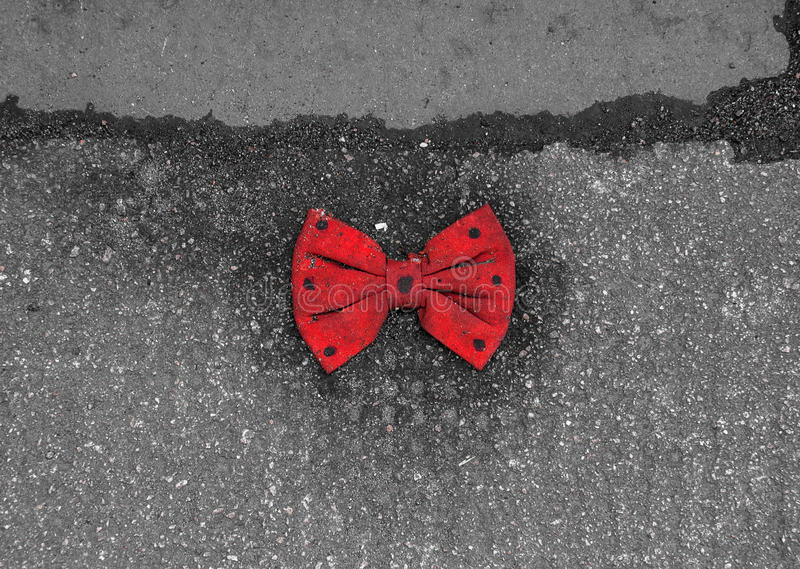 Download Red Bow Tie With Black Dots Lying On The Pavement Stock Photo - Image: 39113590
