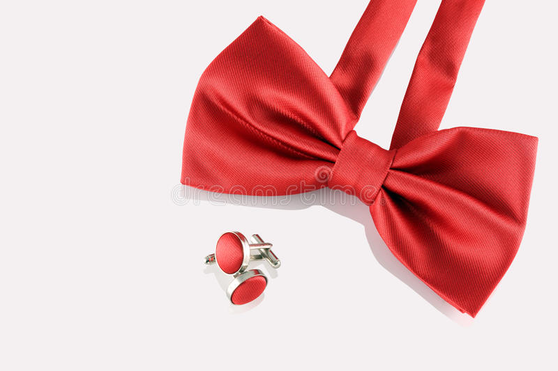 Red bow tie with cuff links. On white background stock photography