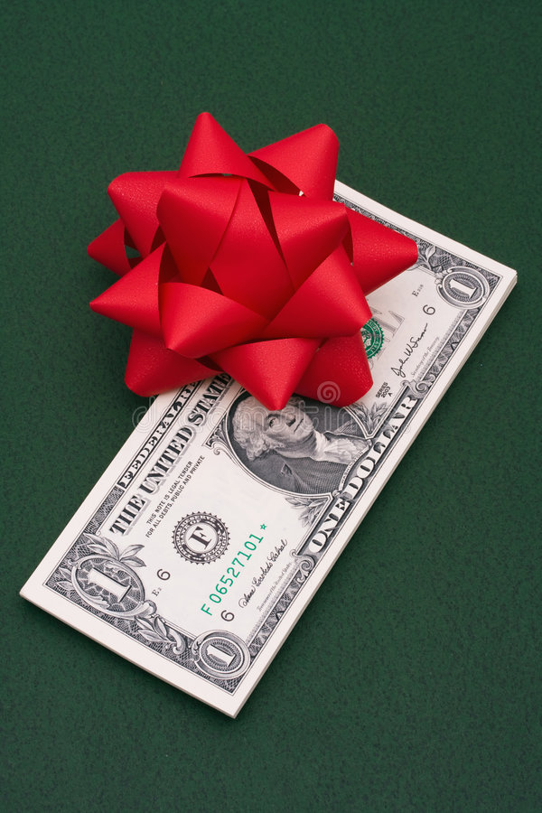 Red Bow On US One Dollar Bills Royalty Free Stock Image