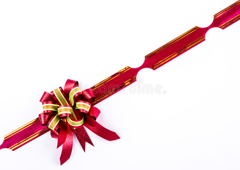 Red bow on white background. In studio stock photo