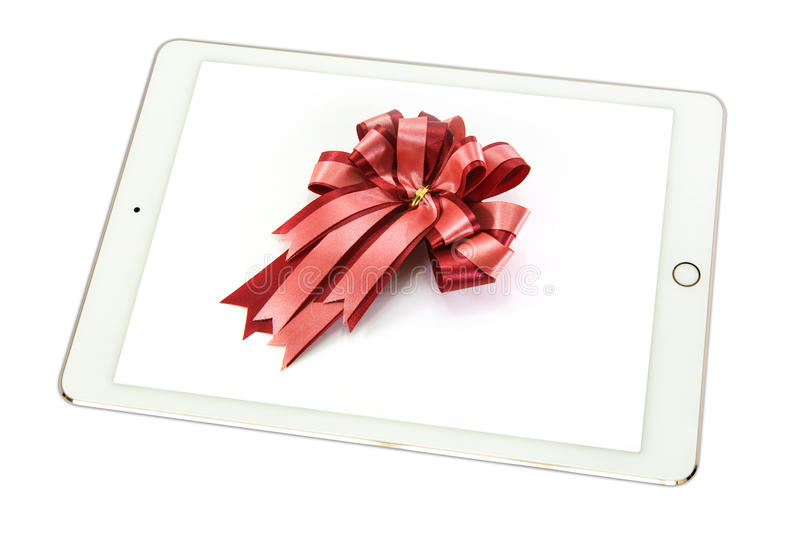 Red bow on a white background in tablet on white background., is stock photography