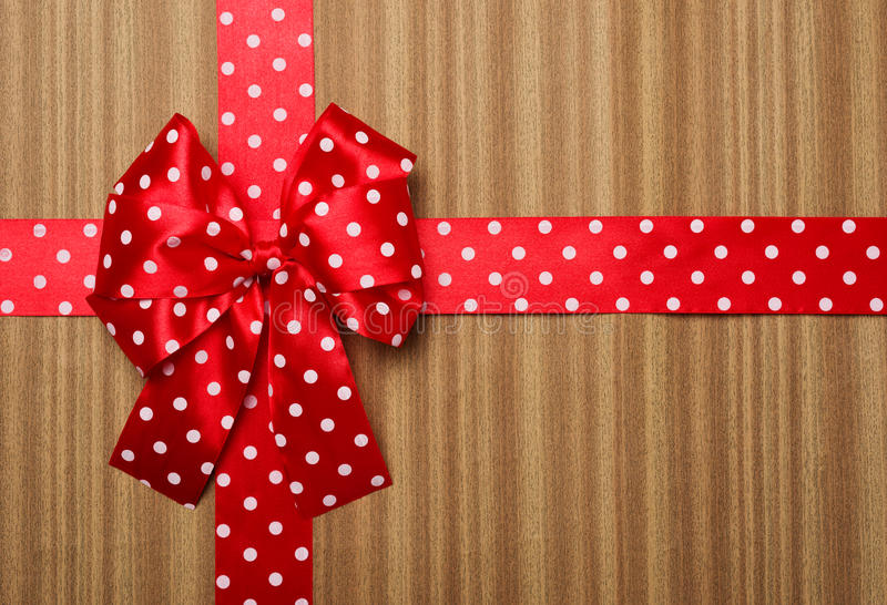 Red bow on wood background. Red bow on wooden background royalty free stock image
