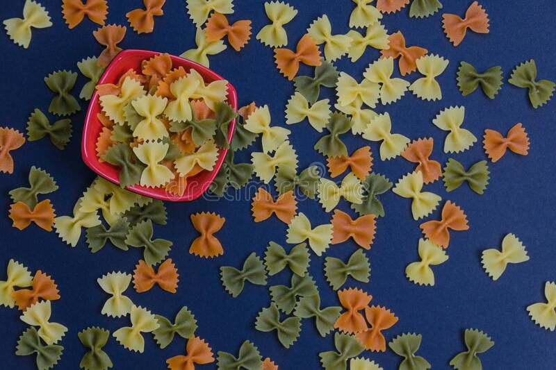 Flat view of bow tie three color pasta royalty free stock photography
