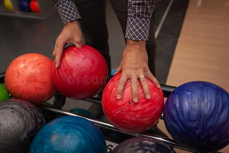 Bowling ball in action with a game of bowling in sports center. Red bowling ball in action with a game of bowling in sports center stock photo