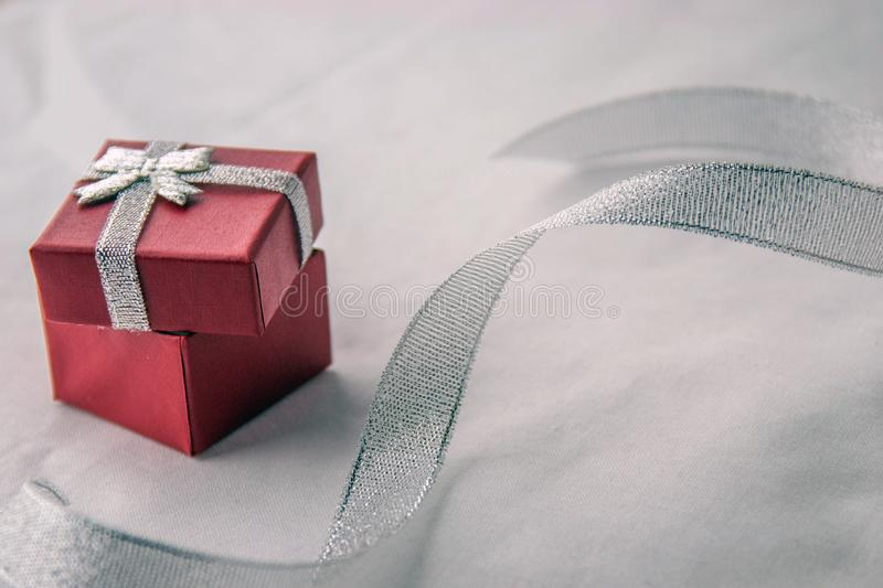 Red box for a gift with silver ribbon. Valentines day! Red box for a gift with silver ribbon , on a white background. Top view royalty free stock photos