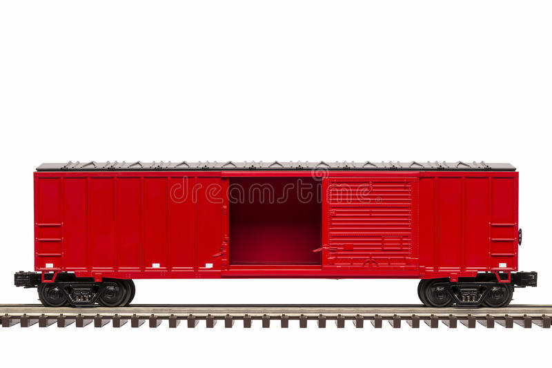 Red Boxcar. A red boxcar on track with the door open stock photo