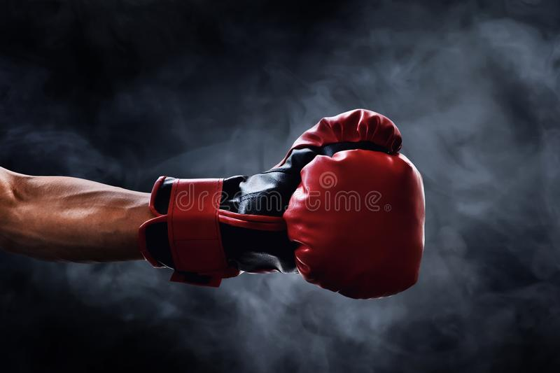 Red boxing glove on smoke backgrounds. Red boxing glove on smoke background royalty free stock photos