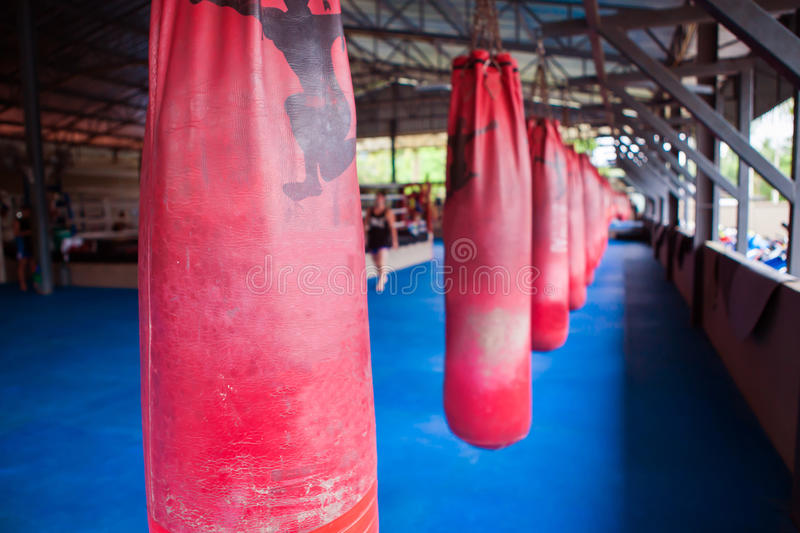 Red Boxing sand bags hanging at gym. stock photography