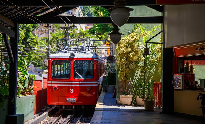 Red Brazilian Train Best Jungle, Tijuca Rio de Janeiro. Red Brazilian train travels through thick, best jungle at Tijuca National Forest in Rio de Janeiro Brazil stock photo