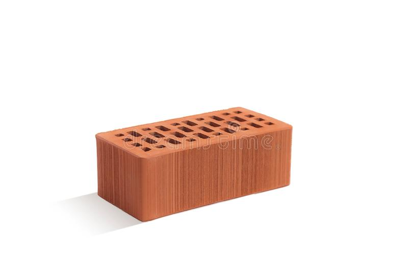Red brick brick block on a white background. Ceramic block of a new development in the construction sector royalty free stock photography