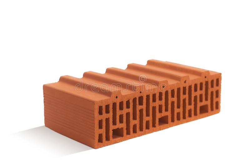 Red brick brick block on a white background. Ceramic block of a new development in the construction sector royalty free stock images