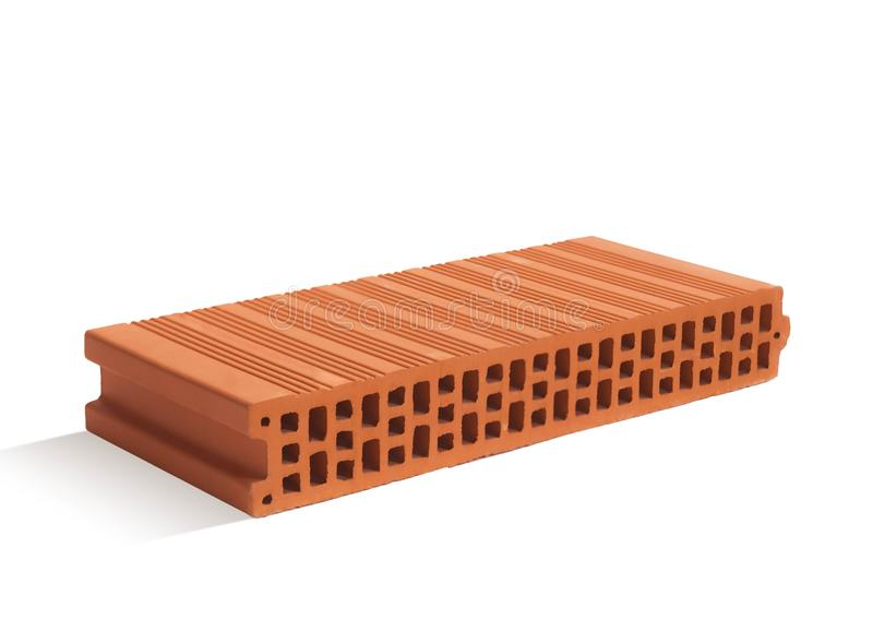 Red brick brick block on a white background. Ceramic block of a new development in the construction sector royalty free stock photos