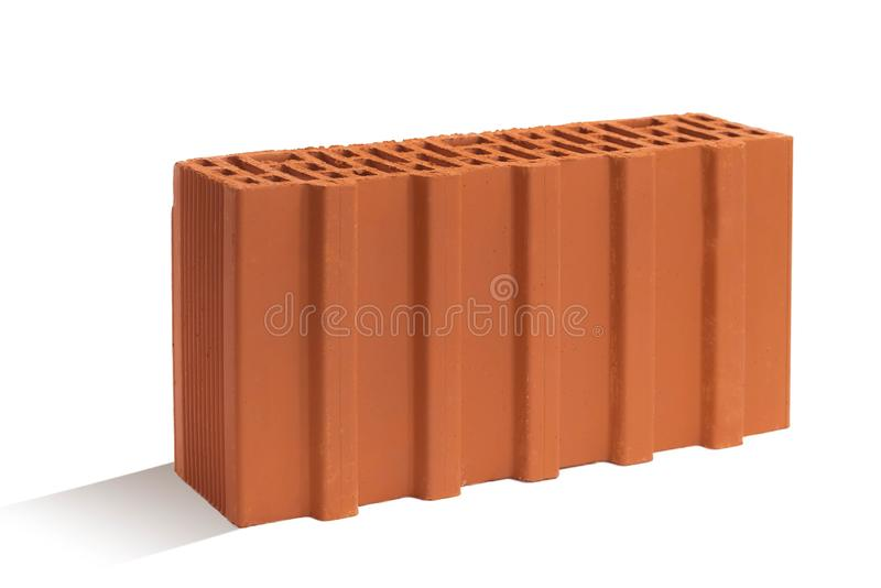 Red brick brick block on a white background. Ceramic block of a new development in the construction sector stock image