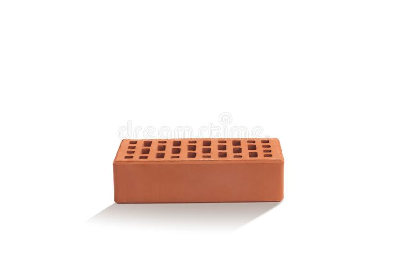 Red brick brick block on a white background. Ceramic block of a new development in the construction sector royalty free stock image